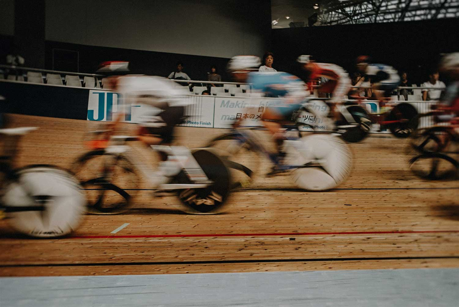 Blurred image of multiple track cyclists during Japan National cycling event at Izu Velodrome