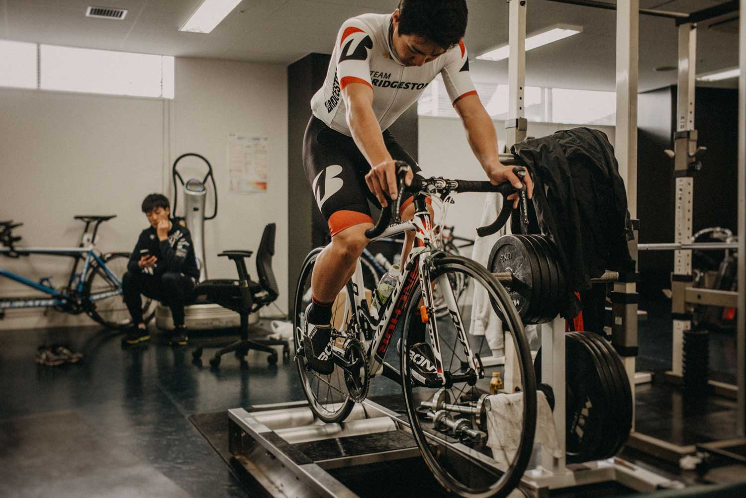 Japan Olympic track cyclist trains on static rollers to test cycling foot orthotics at Izu Velodrome, Japan