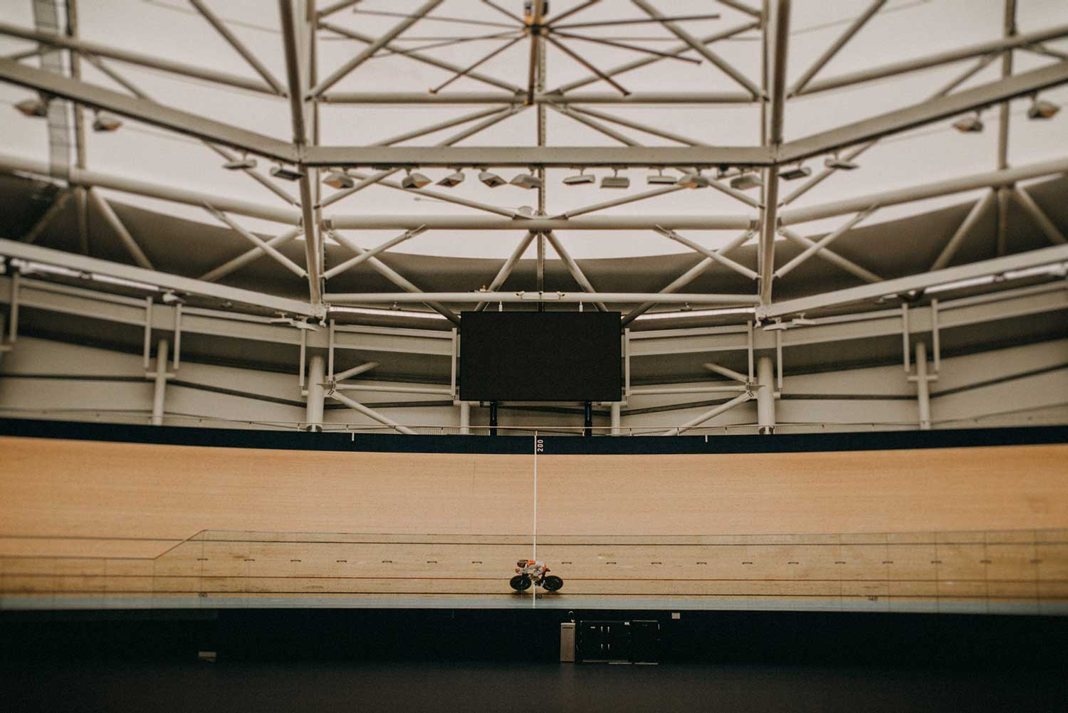 Japanese track cyclist training alone at the indoor velodrome