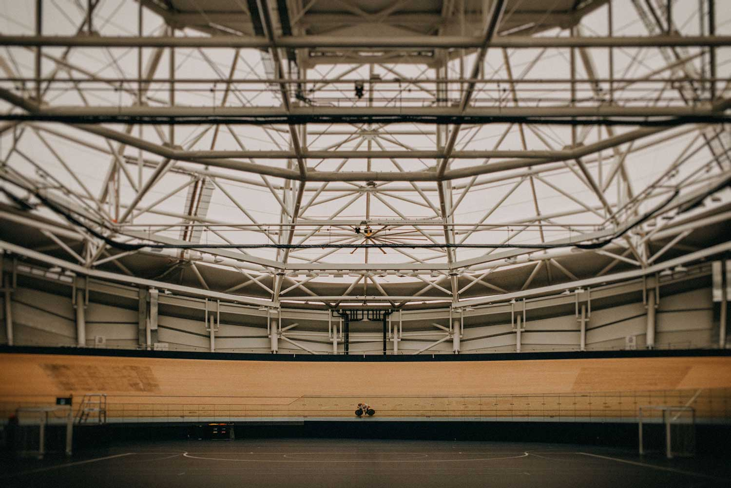 Japanese cyclist trains alone in the indoor velodrome