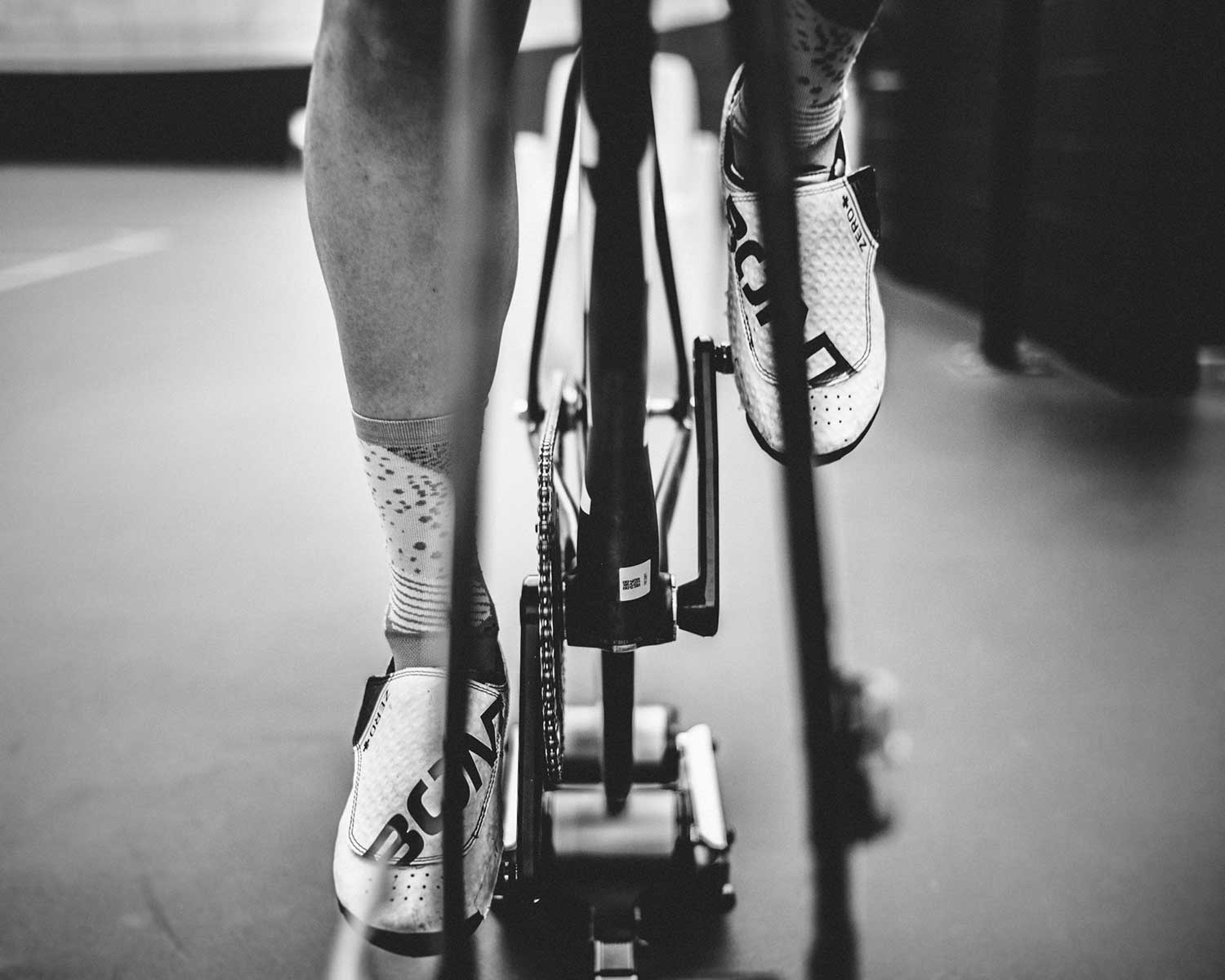 Front view image of cyclist's feet on static bike when training at velodrome